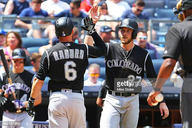 Ryan Raburn of the Colorado Rockies is greeted by Trevor Story after hitting a two-run home runin the fifth inning agains the New York Yankees at...