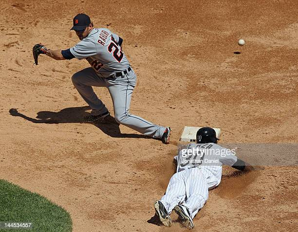 Ryan Raburn of the Detroit Tigers can't handle the throw as Alejandro De Aza of the Chicago White Sox steals second base at U.S. Cellular Field on...