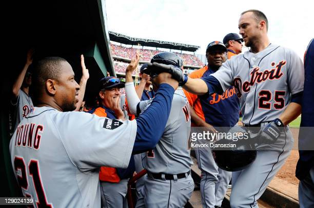 Ryan Raburn of the Detroit Tigers celebrates in the dugout after hitting a three-run home run in the third inning of Game Two of the American League...