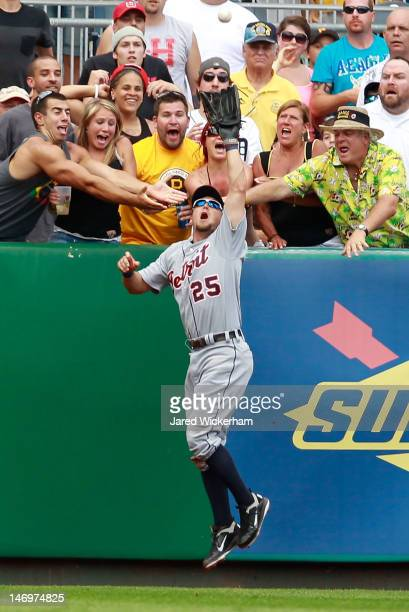 Ryan Raburn of the Detroit Tigers saves a home run by catching a fly ball in the 8th inning at the wall against the Pittsburgh Pirates during the...