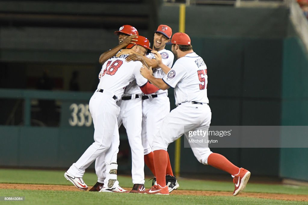 Ryan Raburn #18 of the Washington Nationals celebrates scoring the winning run with teammates in the ninth inning a during a baseball game against the New York Mets at Nationals Park on July 3, 2017 in Washington, DC.