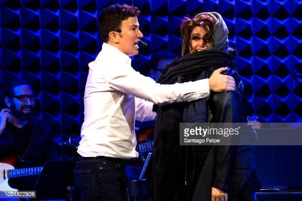 Ryan Raftery and Jess Watkins perform onstage as 'Calvin Klein' and 'Donna Karan' during The Obsession Of Calvin Klein at Joe's Pub on October 28...