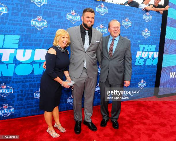 Ryan Ramczyk from Wisconsin along with his mother Lori and father Randy on the Red Carpet outside of the NFL Draft Theater on April 27 2017 in...
