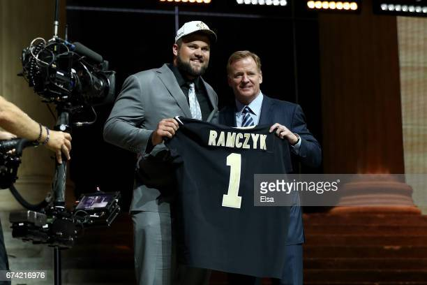 Ryan Ramczyk of Wisconsin poses with Commissioner of the National Football League Roger Goodell after being picked overall by the New Orleans Saints...
