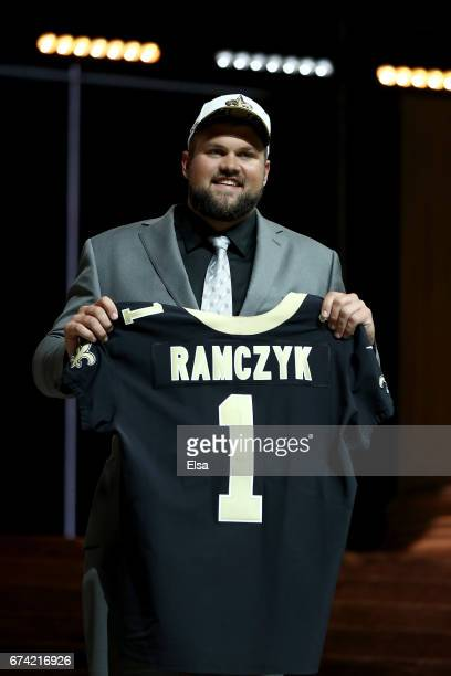 Ryan Ramczyk of Wisconsin reacts after being picked overall by the New Orleans Saints during the first round of the 2017 NFL Draft at the...