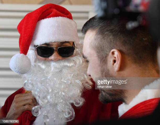 Ryan Reaves of the Vegas Golden Knights dressed as Santa Claus and William Carrier of the Golden Knights dressed as an elf are interviewed after...
