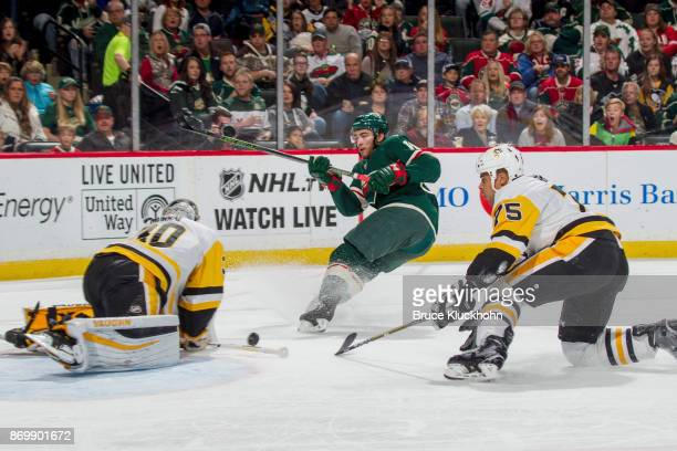 Ryan Reaves and goalie Matt Murray of the Pittsburgh Penguins defend their goal against Luke Kunin of the Minnesota Wild during the game at the Xcel...