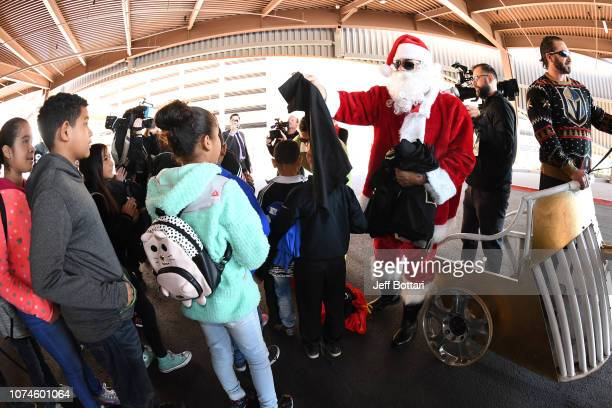 Ryan Reaves and William Carrier of the Vegas Golden Knights arrive at the arena dressed as Santa Claus and his elf to greet a group of children on...
