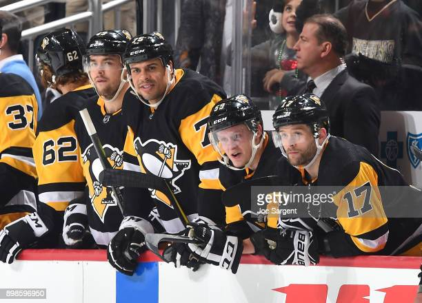 Ryan Reaves Jake Guentzel and Bryan Rust of the Pittsburgh Penguins look on during the game against the Columbus Blue Jackets at PPG Paints Arena on...