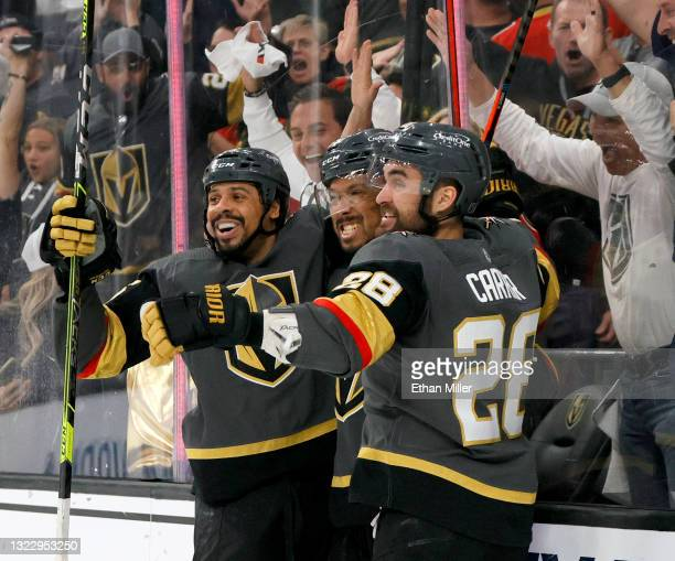Ryan Reaves, Keegan Kolesar and William Carrier of the Vegas Golden Knights celebrate Kolesar's second-period goal against the Colorado Avalanche in...