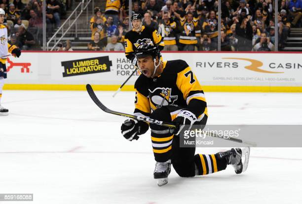Ryan Reaves of the Pittsburgh Penguins celebrates after scoring a goal against the Nashville Predators at PPG PAINTS Arena on October 7 2017 in...