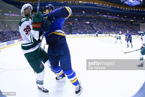 Ryan Reaves of the St Louis Blues checks Nate Prosser of the Minnesota Wild in Game Three of the Western Conference First Round during the 2017 NHL...