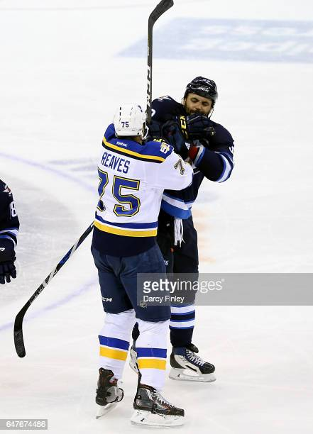Ryan Reaves of the St Louis Blues mixes it up with Dustin Byfuglien of the Winnipeg Jets during a second period scrum at the MTS Centre on March 3...