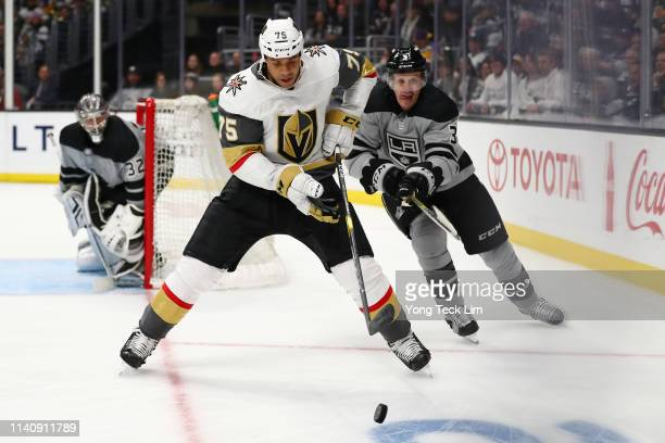 Ryan Reaves of the Vegas Golden Knights advances the puck against Dion Phaneuf of the Los Angeles Kings during the third period at Staples Center on...