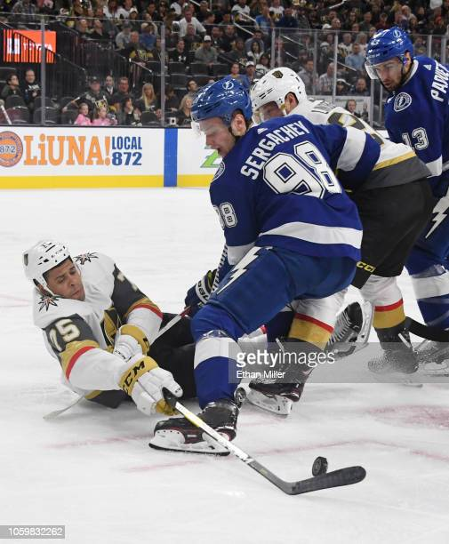 Ryan Reaves of the Vegas Golden Knights and Mikhail Sergachev of the Tampa Bay Lightning battle for the puck off the faceoff in the second period of...