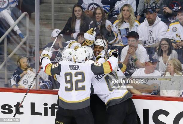 Ryan Reaves of the Vegas Golden Knights celebrates with teammates after scoring a second period goal against the Winnipeg Jets in Game Five of the...