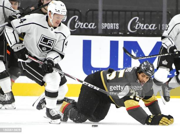 Ryan Reaves of the Vegas Golden Knights falls to the ice as he defends without a stick against Mikey Anderson of the Los Angeles Kings after Reaves'...