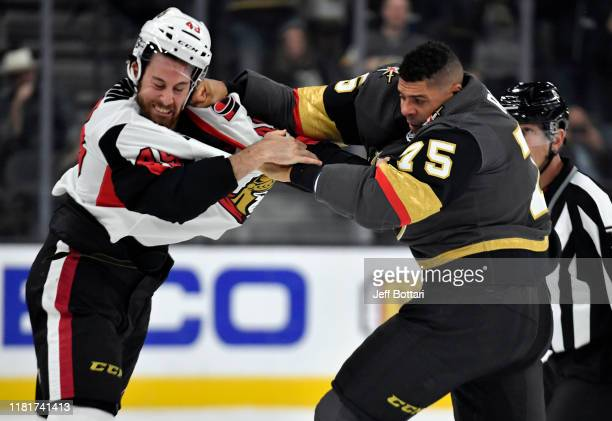 Ryan Reaves of the Vegas Golden Knights fights Scott Sabourin of the Ottawa Senators during the first period at TMobile Arena on October 17 2019 in...