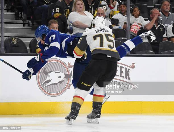Ryan Reaves of the Vegas Golden Knights hits Victor Hedman of the Tampa Bay Lightning into the boards in the second period of their game at TMobile...