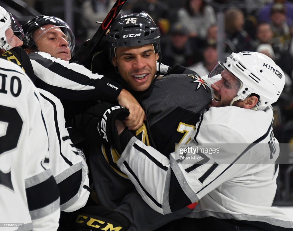 Ryan Reaves #75 of the Vegas Golden Knights is grabbed by linesman Jonny Murray and Torrey Mitchell #71 of the Los Angeles Kings during a scuffle in the second period of their game at T-Mobile Arena on February 27, 2018 in Las Vegas, Nevada.