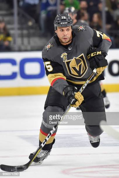 Ryan Reaves of the Vegas Golden Knights skates with the puck against the Vancouver Canucks during the game at TMobile Arena on March 20 2018 in Las...