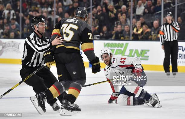 Ryan Reaves of the Vegas Golden Knights taunts Tom Wilson of the Washington Capitals after a hit during the first period of a game at TMobile Arena...