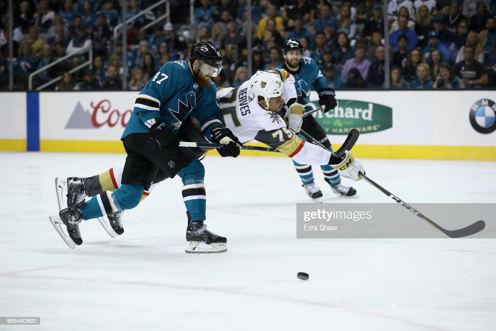 Ryan Reaves #75 of the Vegas Golden Knights tries to put a shot on goal as he is hit by Joakim Ryan #47 of the San Jose Sharks during Game Six of the Western Conference Second Round during the 2018 NHL Stanley Cup Playoffs at SAP Center on May 6, 2018 in San Jose, California.