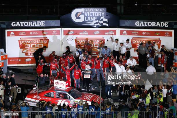 Ryan Reed driver of the Lilly Diabetes Ford celebrates in Victory Lane after winning the NASCAR XFINITY Series PowerShares QQQ 300 at Daytona...