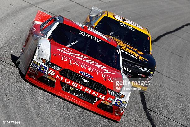 Ryan Reed driver of the Lilly Diabetes/American Diabetes Association Ford leads Brendan Gaughan driver of the South Point Chevrolet during the NASCAR...