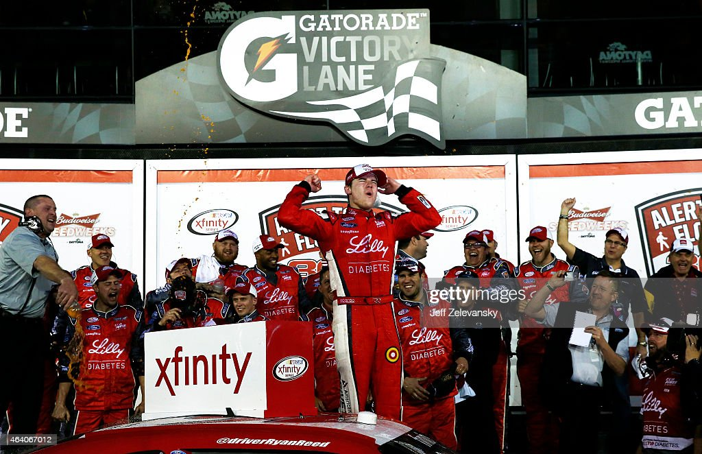 Ryan Reed, driver of the #16 Lilly/American Diabetes Association Ford, celebrates in Victory Lane after winning the NASCAR XFINITY Series Alert Today Florida 300 at Daytona International Speedway on February 21, 2015 in Daytona Beach, Florida.