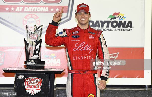 Ryan Reed driver of the Lilly/American Diabetes Association Ford celebrates in Victory Lane after winning the NASCAR XFINITY Series Alert Today...