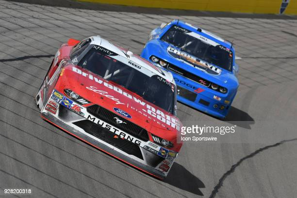 Ryan Reed Roush Fenway Racing Ford Mustang dives into turn one ahead of Timmy Hill Carl Long Toyota Camry during the NASCAR Xfinity Series Boyd...