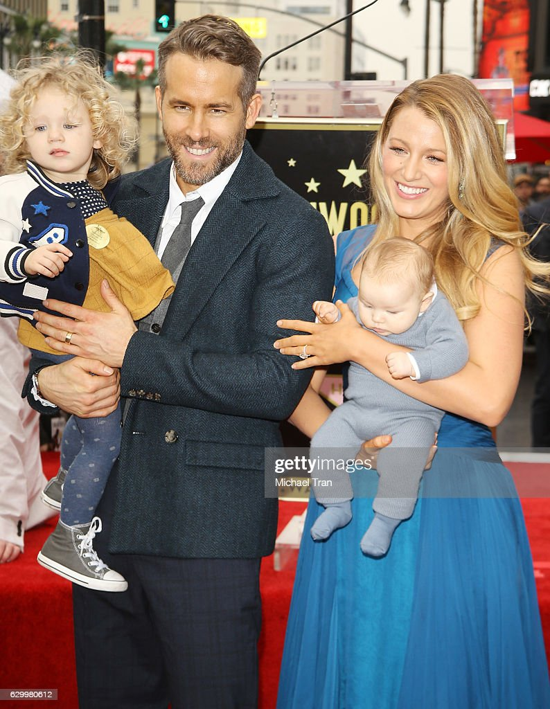 Ryan Reynolds (L) and Blake Lively with their daughters attend the ceremony honoring actor Ryan Reynolds with a Star on The Hollywood Walk of Fame held on December 15, 2016 in Hollywood, California.