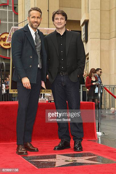 Ryan Reynolds and Nathan Fillion attend a ceremony honoring actor Ryan Reynolds with Star on the Hollywood Walk Of Fame on December 15 2016 in...