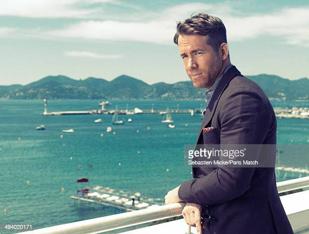 Ryan Reynolds poses at the Club Costes by Albane during the 67th Cannes film festival on May 16 2014 in CannesFrance