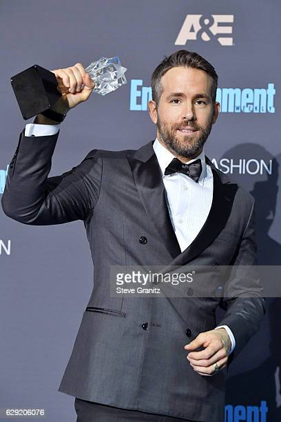 Ryan Reynolds poses in the press room after winning the award for Entertainer Of The Year during The 22nd Annual Critics' Choice Awards at Barker...