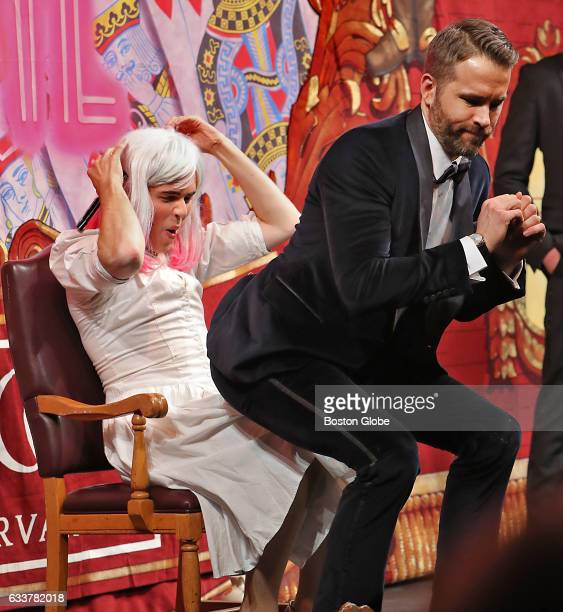 Ryan Reynolds this year's recipient of the Hasty Pudding Man of the Year Award gives a lap dance to Kyle Whelihan who is playing his zombie wife...