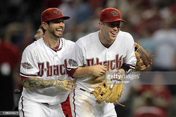 Ryan Roberts and Paul Goldschmidt of the Arizona Diamondbacks celebrate the Diamondbacks 8-1 victory against the Milwaukee Brewers in Game Three of...