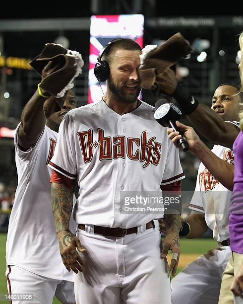 Ryan Roberts of the Arizona Diamondbacks gets a shaving cream saluate from Justin Upton and Chris Young after Roberts hit a walk off threerun home...