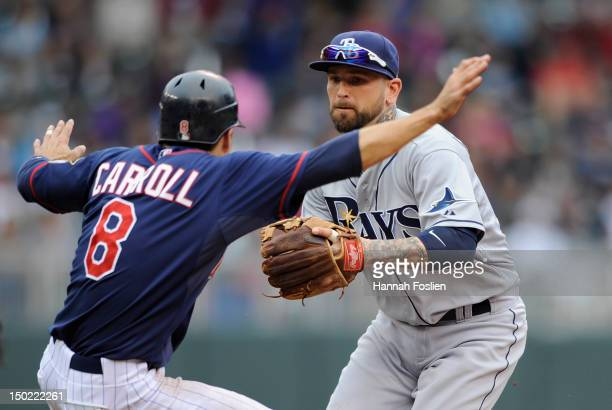 Ryan Roberts of the Tampa Bay Rays tags out Jamey Carroll of the Minnesota Twins during the fifth inning on August 12 2012 at Target Field in...
