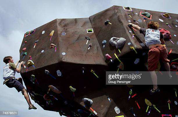 Ryan Roden of Dallas, Texas and Brian Antheunisse, Texas climb seperate routes during the Pro Bouldering Qualifier during The Teva Mountain Games on...