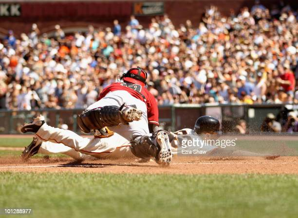 Ryan Rohlinger of the San Francisco Giants is tagged out by Chris Snyder of the Arizona Diamondbacks at ATT Park on May 30 2010 in San Francisco...