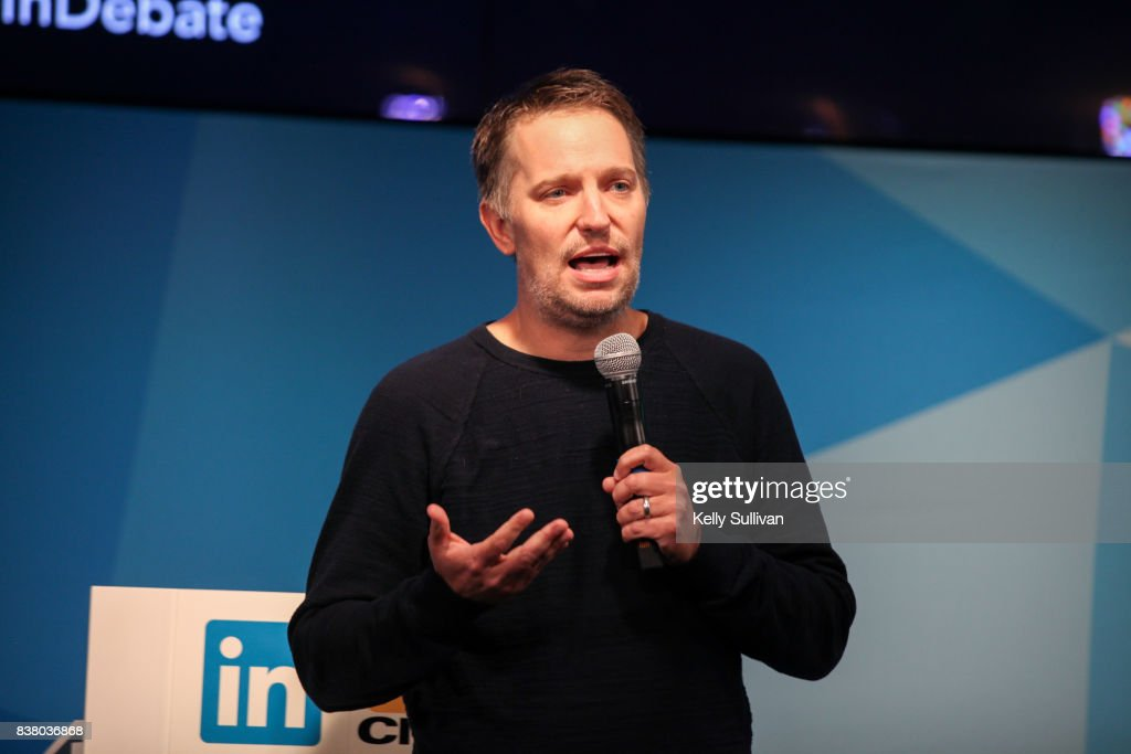 Ryan Roslansky, Head of Product at LinkedIn, introduces debate participants on August 23, 2017 at LinkedIn in San Francisco, California.