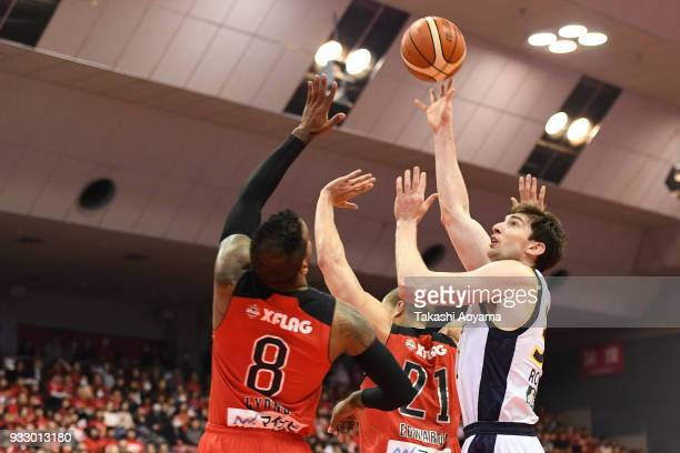 Ryan Rossiter of the Tochigi Brex shoots while under pressure from Leo Lyons and Gavin Edwards of the Chiba Jets during the BLeague game between...