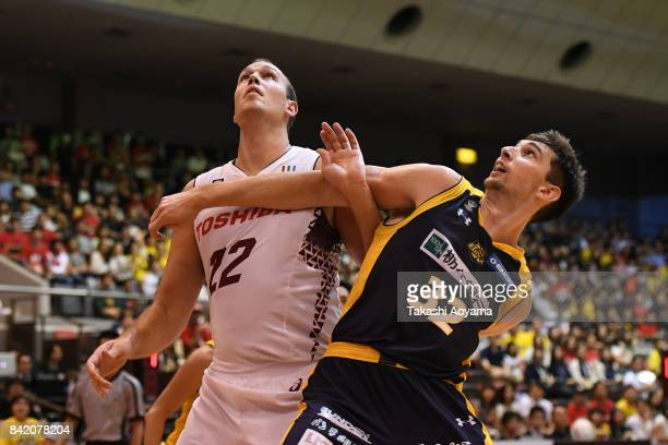 Ryan Rossiter of Tochigi Brex and Nick Fazekas of the Kawasaki Brave Thunders battle for position under the boards during the BLeague Kanto Early Cup...