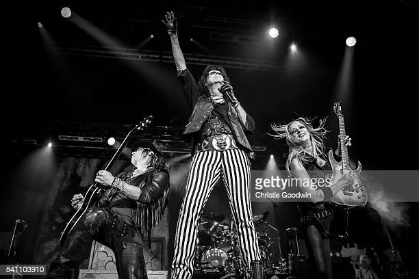 Ryan Roxie , Alice Cooper and Nita Strauss perform on stage at The O2 Arena on June 18, 2016 in London, England.