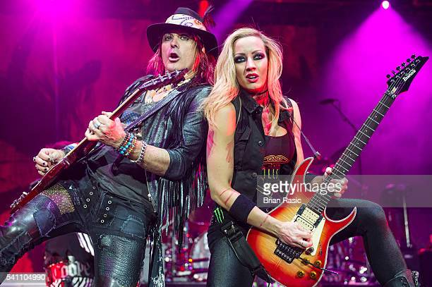 Ryan Roxie and Nita Strauss of Alice Cooper band perform at The O2 Arena on June 18, 2016 in London, E2ngland.
