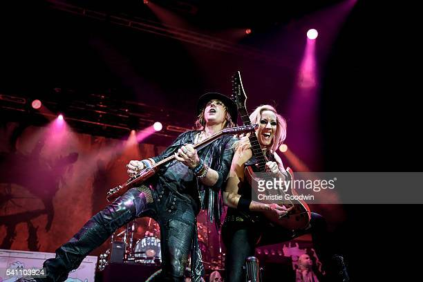 Ryan Roxie and Nita Strauss of Alice Cooper's band perform on stage at The O2 Arena on June 18, 2016 in London, England.