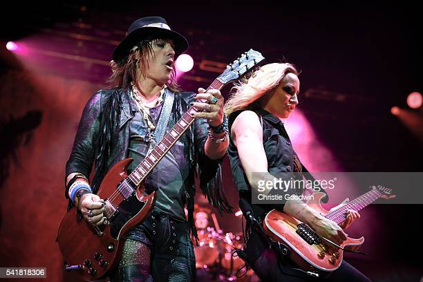 Ryan Roxie and Nita Strauss of Alice Cooper's band perform on stage at The O2 Arena on June 18 2016 in London England