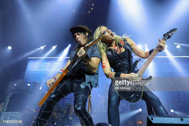 Ryan Roxie and Nita Strauss of the band Alice Cooper performs at the BBT Pavilion August 16 2019 in Camden New Jersey